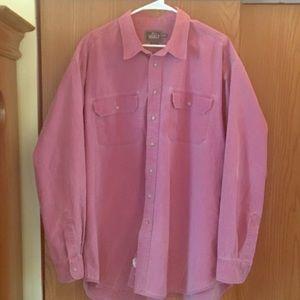 Pink denim button up shirt.